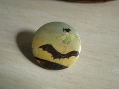 Flight of the Bat Fairy vintage style pinback button.  Only $1.49 at https://www.etsy.com/listing/150901719/flight-of-the-bat-fairy-pinback-button?ref=shop_home_active