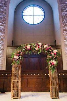 Pink + Blush wedding arch for indoor Winter Colorado Wedding