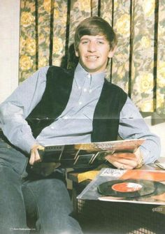 RINGO STARR WITH SOME RECORDS....
