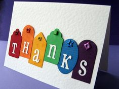 handmade thank-you card ... white die cut letters on brightly colored tags of different shapes ... happy look ... luv it!!