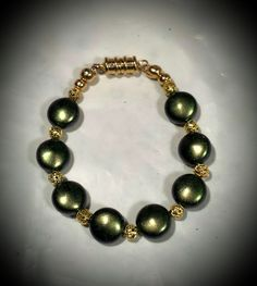 Green Swarovski Crystal Pearl Coins, Gold Finished Metal Ball 5 3/4 Inch Bracelet for Young Girls Four to Five Years Old ETSY $11 https://www.etsy.com/listing/511919032/rich-iridescent-green-swarovski-crystal