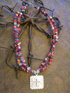 Bright and beautiful multicolored beaded necklace with stunning cross concho pendant. $40