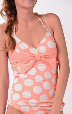 Beach Cruiser Tankini @DownEast Basics #SpringStyle. Sizes: 2-18. Fitted tankini with cross-over and bow detail at bust. narrow tie halter strap  Lightly padded cups (removable)  Lined  80% nylon; 20% spandex  $39.99 for top only.