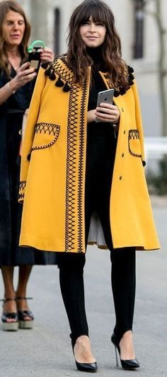 Paris Fashion Week Street Style: Miroslava Duma in a yellow embroidered coat.