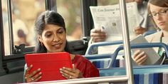 Jehovah's Witnesses study on their electronic devices while riding public transportation