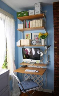 Beautiful shade of blue in this tiny home office | Michelle Dunn Small desk with shelves ~ originally from Apartment Therapy.