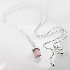 0130  A simple, minimalist silver necklece with beautiful, pink tourmaline. The stone is framed in satinated silver and the chain and clasp are polished. Entirely hand made.  $114.64 Click to see details!