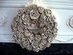 """""""Make rolled roses from newsprint, and turn them into a very heavy duty wreath! Not for outside, but great for anywhere indoors! You could also lightly spray ..."""" 