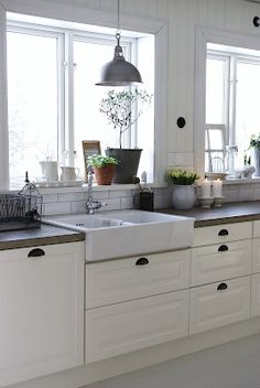concrete counter top and a farmhouse sink