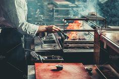 Preparing traditional beef steak. Food & Drink Photos