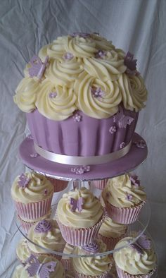 Cream and lavender cupcake tower with a giant cupcake on top - so adorable…