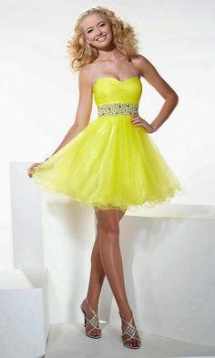 5a2057b0d Si los vestidos cortos de noche en color naranja ponen la nota más ácida a  la