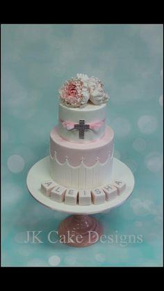 Christening cake with handmade cross topper