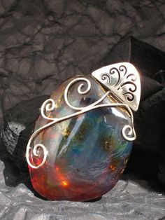 Blue amber pendant, Mother Goddess of the Blue Earth - powerful burning blue natural Dominican amber peeble