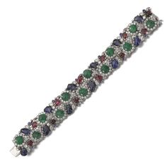 Gem set and diamond bracelet, Van Cleef & Arpels, circa 1935 Set with carved emeralds, sapphires and rubies, sapphire cabochons, circular-, single-cut and marquise-shaped diamonds, length approximately 180mm, signed Van Cleef & Arpels, numbered, French assay and maker's marks.