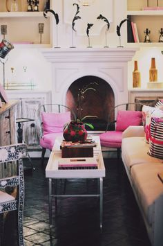 pink and tan; also love the 1 black feather in white vases on the matnel