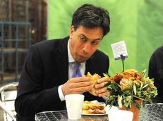 Labour leader Ed Miliband struggles with a bacon sandwich at New Covent Garden Market in London as he kicks off a day of campaigning on the eve of the local and European elections.