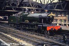 "7802 ""Bradley Manor"" is ready to work the Cambrian Coast Express at Shrewsbury, by T. Road Train, Train Car, Diesel Locomotive, Steam Locomotive, Steam Trains Uk, Name Train, Best Wagons, Heritage Railway, Steam Railway"