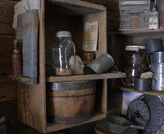 Primitive wood bucket, candle holder and log cabin.