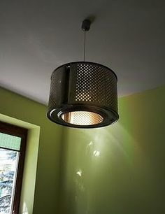 See this cool industrial light? It's a washing machine drum! I love it!