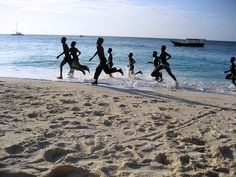 children running up and down the beach in Nungwe, Zanzibar     .     >>>Getting what YOU want out of LIFE by Helping enough OTHER people Get what THEY WANT. #Serving is Awesome!!!  ;o)