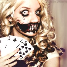 Alice in wonderland zombie makeup... This would look amazing for Halloween. :)