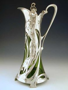 Silver plate on pewter claret jug with a green glass liner and stunning full length art nouveau maiden decoration, Germany, c.1906