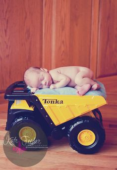 """Upon seeing these pictures of a strange baby in HIS dumptruck, my 2-year-old son, Stone asked """"Dump him?"""". Hahahahaha!!"""
