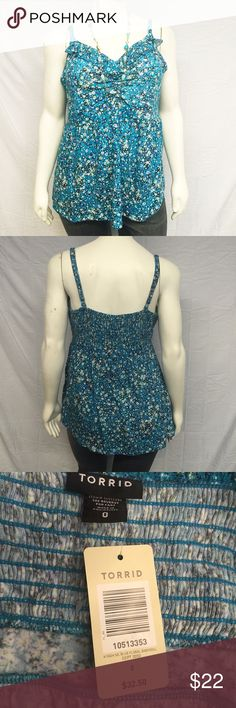 """{0X 1X 2X 4X} Torrid Floral Ruffle Top Cute tank from torrid that features a blue ditzy print. Babydoll empire waist with a gathered bust. Ruffled neckline. Smocked back. Adjustable spaghetti straps. New with tags, never worn. Smoke and pet free home. Measurements are approximate. 0X: 30"""" bust. 29"""" long. 1X: 34"""" bust. 29"""" long. 2X: 38"""" bust. 30"""" long. 4X: 44"""" bust. 30"""" long. torrid Tops Tank Tops"""