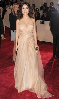 Salma Hayek's dress is from Alexander McQueen's couture range, and her clutch bag is from the SS 2011 collection.