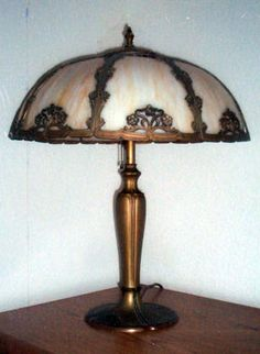 A slag glass lamp, created around 1920.