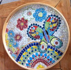 Round mosaic tray with a butterfly..I love this!
