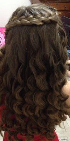 french braid with wanded curly hair