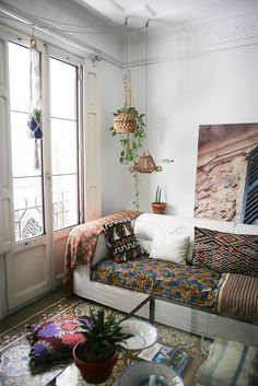 Name: Laura and Carlos Location: Valencia, Spain Size: 160 square meters (1722 square feet) Years lived in: 3 years Like the lovely, hand-made macrame that Laur