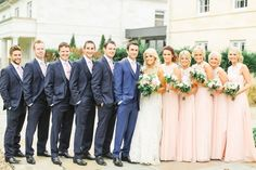Summer Bridal Party Portrait in peach dresses & Navy Suit s- Image by Belle and Beau Photography - An Ian Stuart 'Sapphire' bridal gown for a classically romantic wedding at Rudding Park in Harrogate with a Dahlia bouquet and pink bridesmaid dresses www. Pink Grey Wedding, Navy Wedding Flowers, Summer Wedding Colors, White Wedding Bouquets, Tuxedo Wedding, Peach Bridesmaid Dresses, Blue Bridesmaids, Wedding Bridesmaids, Wedding Attire