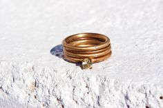 18k gold vintage finish eco-friendly diamond stacking band set.  Simple delicate thin feminine rustic engagement ring or wedding band.. $2,050.00, via Etsy.