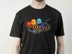 Ghosts in Mourning  This is a creative tee design from Ghostbusters. #pacman #tshirt