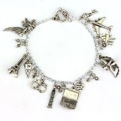 This enchanted bracelet is inspired by Fifty Shades of Grey Trilogy. The charms represent: ~the mask from 50 Shades of Black ~Eiffel Tower for their honeymoon in Paris ~Christian's piano ~the Big Ben