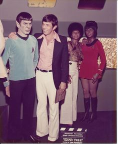 """Late 1960's: Leonard Nimoy & Nichelle Nichols visit their """"Star Trek"""" counterparts, Mr. Spock & Uhura, in the San Francisco Wax Museum collection from Movieland."""