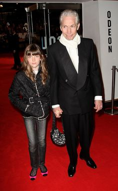 Rolling Stones member Charlie Watts and his daughter Charlotte arrive at the UK premiere of 'Shine a Light' at the Odeon Leicester Square on April 2, 2008 in London, England.
