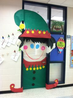 Christmas Elf decorated on classroom door.