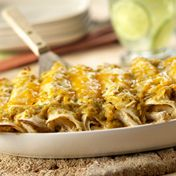 Warm tortillas are filled with an enticing combination of shredded chicken, SalsaVerde, sour cream, and Cheddar Jack cheese, and are baked until the filling is hot and the cheese is melted.