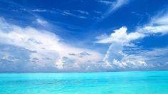Ciel bleu – Lagon – Magnifique paysage – Mer – Nuages