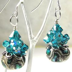 Teal, Black and White Earrings, Swirl Lampwork and Blue Zircon Swarovski Crystal Confetti. $35.00, via Etsy.