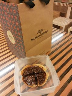 Indonesia famous desert that we called as Martabak. Many variation toppings we can add into this martabak such as ovomaltine like in the picture.