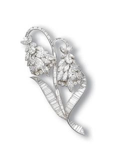 A DIAMOND BROOCH, BY VAN CLEEF & ARPELS    Designed as the lily of the valley, set with marquise, brilliant and pear-shaped diamonds, enhanced by a marquise-cut diamond swinging pistil, to the baguette-cut diamond stem and leaves, mounted in 14k white gold, 8.4 cm high    Signed VCA for Van Cleef & Arpels, no. 29568