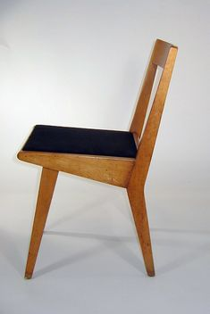 Jens Risom, wooden stacking chair, 1952 USA for Knoll. Acquired by Cooper Hewitt in 1990. Black textile for seat.