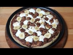 Chocolate Dessert Pizza is a decadent sweet treat that everyone will be talking about. A pizza base is lightly baked and smothered in rich Nutella spread. Decorated with banana, marshmallows, chocolate pieces and chopped candy bars, this amazing dessert is easily adapted to suit your personal tastes - give it a go!