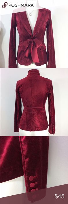 """Gorgeous WHBM red velvet blazer jacket This one is Mom's! Gorgeous red velvet with optional fabric tie. Hook and eye closure can be worn closed with tie or open. Beautiful details. Really pretty for winter months. Dress up or down. Very nice condition, Mom takes wonderful care of her clothes. Measured flat is 17.5"""" armpit to armpit, 14.5"""" waist, 23"""" long from the shoulder. Size 00, fits more like a WHBM 0. Listing as 0. Non smoking home. White House Black Market Jackets & Coats Blazers"""