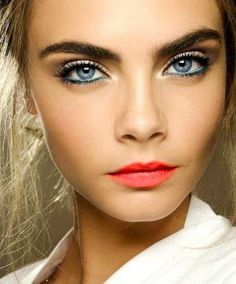 Just for fun!! And remember how good that really bright lip color looked on you?? Try a blue eyeliner like this! Cara Delevingne